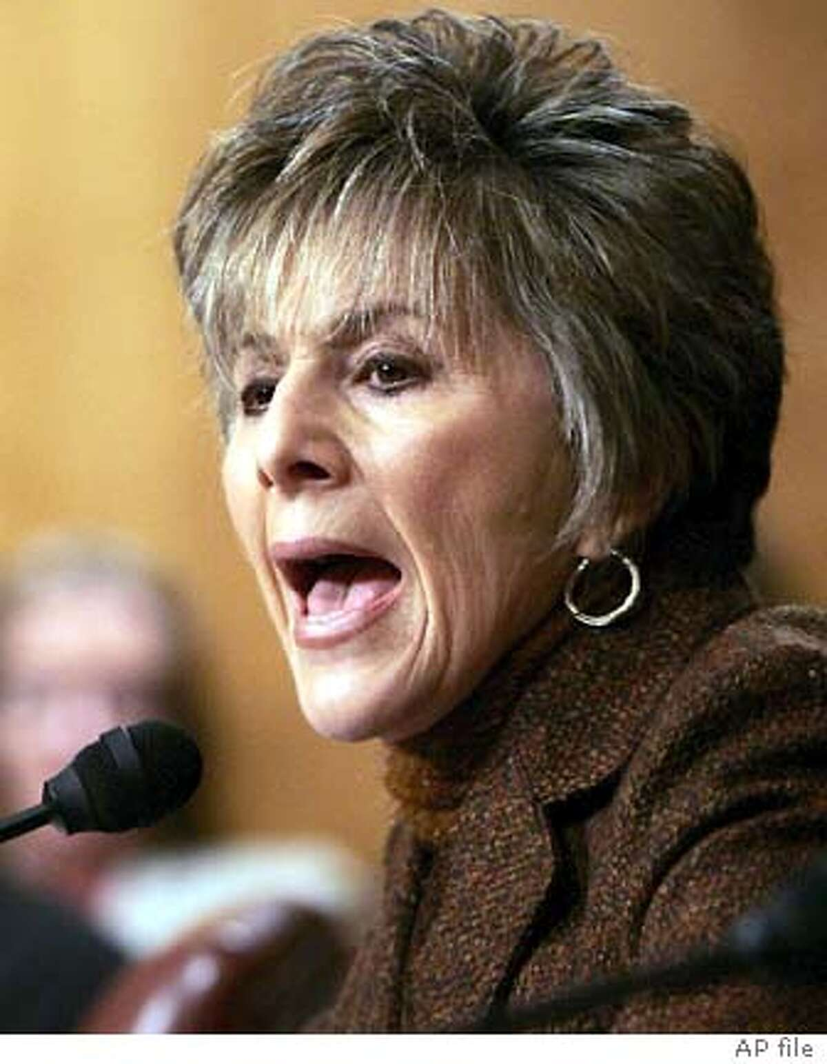 Sen. Barbara Boxer, D-Calif., makes a comment to former assistant Secretary of State for Intelligence and Research Carl W. Ford Jr., (not in picture) as he testifies before the Senate Foreign Relations Committee on the nomination of John Bolton as ambassador to the U.N on Capitol Hill, Tuesday, April 12, 2005. Ford, a former chief of the State Department's bureau of intelligence and research castigated Bolton on Tuesday as a 'kiss-up, kick-down sort of guy' who abused analysts who disagreed with his views of Cuba's weapons capabilities. Seated in back center is Sen. Christopher Dodd, D-Conn. (AP Photo/Manuel Balce Ceneta) Boxer