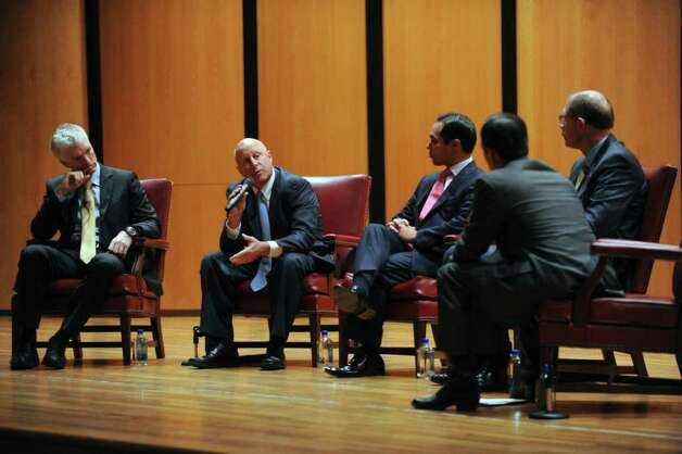 "International education expert Andreas Schleicher, left, Harlandale schools superintendent Robert Jaklich, Mayor Julian Castro, State Rep. Mike Villarreal and David Anthony, CEO of Raise Your Hand Texas, talk about education at the ""Learning the World: Lessons in Education from the Highest Performing Nations"" event at Trinity University on Friday, Jan. 20, 2012. BILLY CALZADA / San Antonio Express-News  JLloyd story Photo: Billy Calzada, San Antonio Express-News / San Antonio Express-News"
