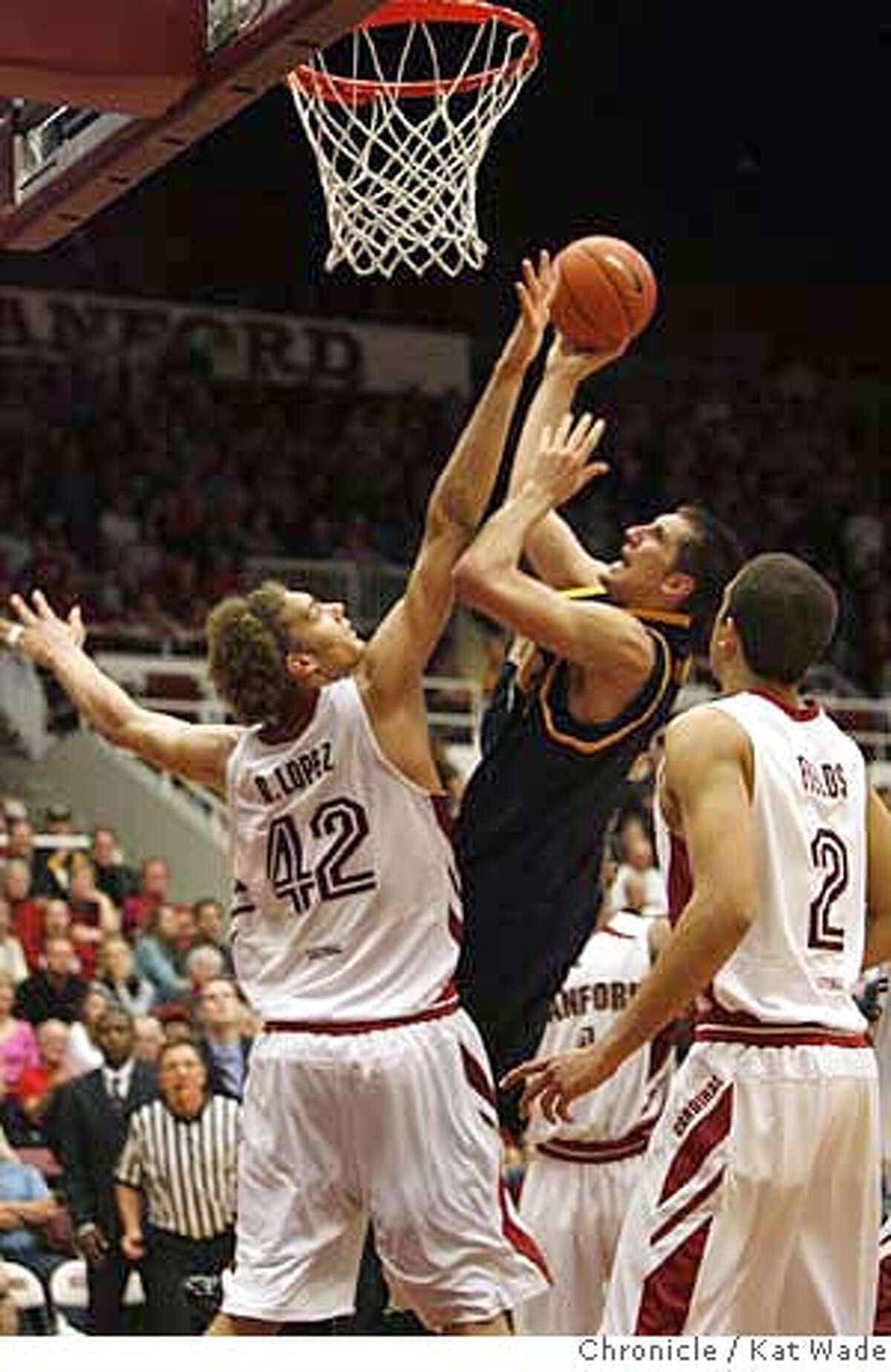 CAL_STANFORD_2_0640_KW_.jpg Cal State Golden Bear's Ryan Anderson shoots over Stanford's Robin Lopez (left) and Landry Fields during the second period of the win against the Stanford during the Pac 10 Conference Game at Stanford University in the Maples Pavilion in Palo Alto on January 3, 2007. Alex Pribble (right) #31 seems happy with the win Kat Wade/The Chronicle Mandatory Credit for San Francisco Chronicle and photographer, Kat Wade, Mags out