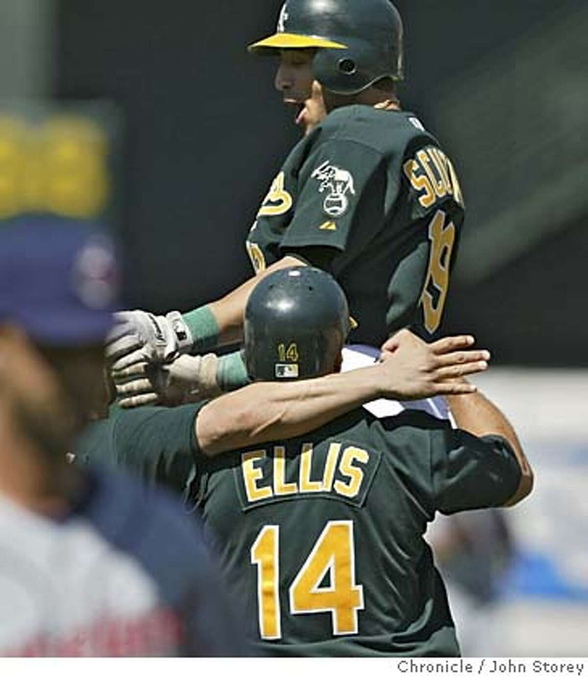 Marco Scutaro of the A's is hugged by Mark Ellis after he drove in the winning run in the 10th inning to beat the Indians. The Oakland A's beat the Cleveland Indians in 10 innings at the McAfee Coliseum. John Storey Oakland Event on 7/27/05 -