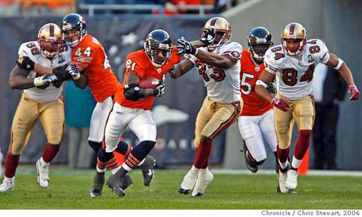 49ers_704_cs.jpg Chicago Bears wide receiver Rashied Davis (81) stiff arms 49ers safety Tony Parrish (33) as he runs for yardage on a fourth quarter punt return. The San Francisco 49ers lost to the Chicago Bears 41-10 in an error-filled game today, October 29, 2006 at Soldier Field in Chicago. Chris Stewart / The Chronicle San Francisco 49ers, Chicago Bears MANDATORY CREDIT FOR PHOTOG AND SF CHRONICLE/ -MAGS OUT