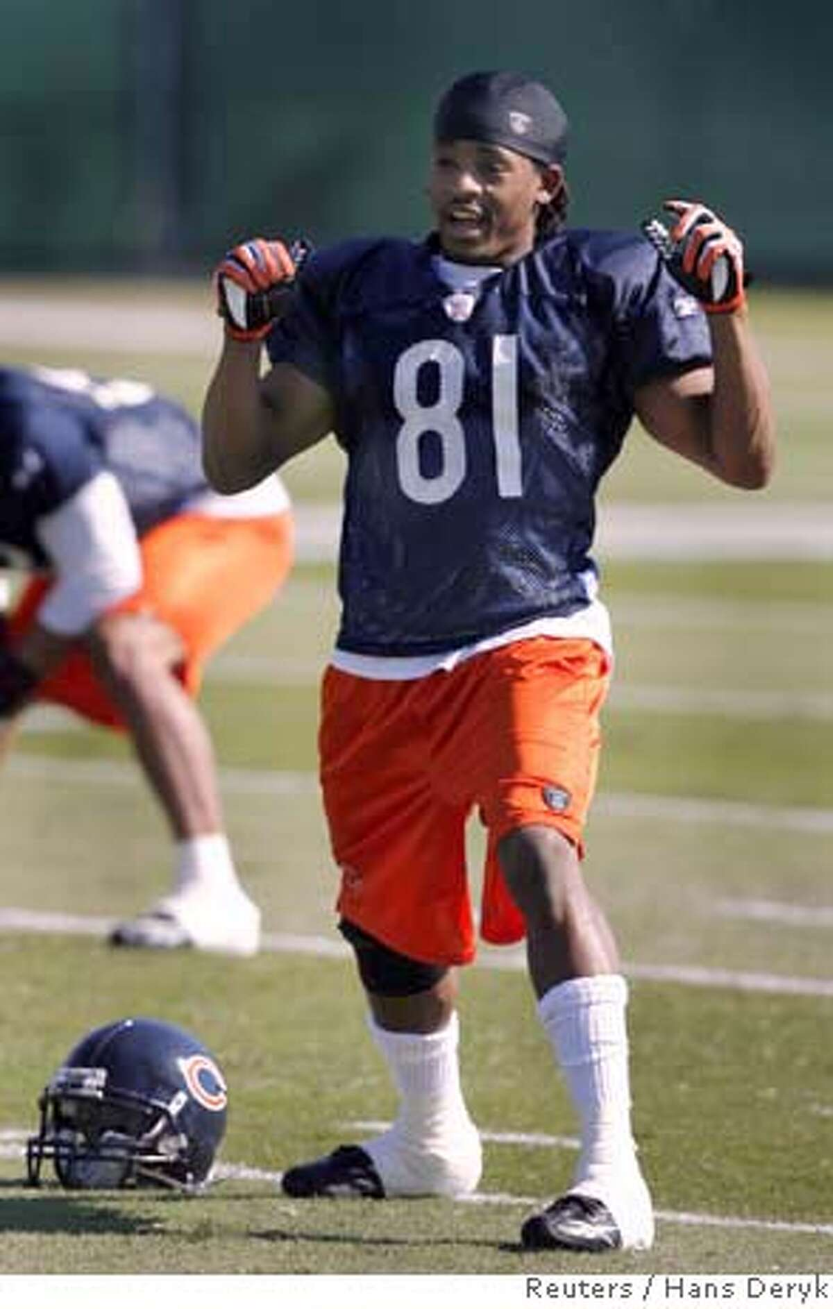 Chicago Bears Rashied Davis laughs as he stretches during practice at the University of Miami campus in Coral Gables January 31, 2007. The Bears continued their preparation for Super Bowl XLI against the Indianapolis Colts on February 4. REUTERS/Hans Deryk (UNITED STATES)