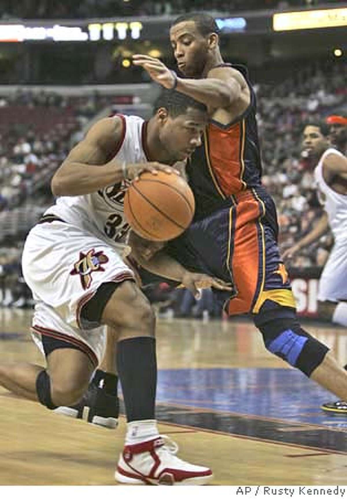 Philadelphia 76ers' Willie Green runs into Golden State Warriors' Monta Ellis during the second half of an NBA basketball game Friday, Feb. 2, 2007, in Philadelphia. (AP Photo/Rusty Kennedy)