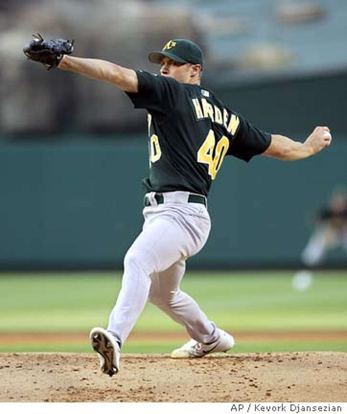 Oakland Atheltics' pitcher Rich Harden unwinds against the Los Angeles Angels during the first inning of the game Tuesday, July 19, 2005, in Anaheim, Calif. (AP Photo/Kevork Djansezian)