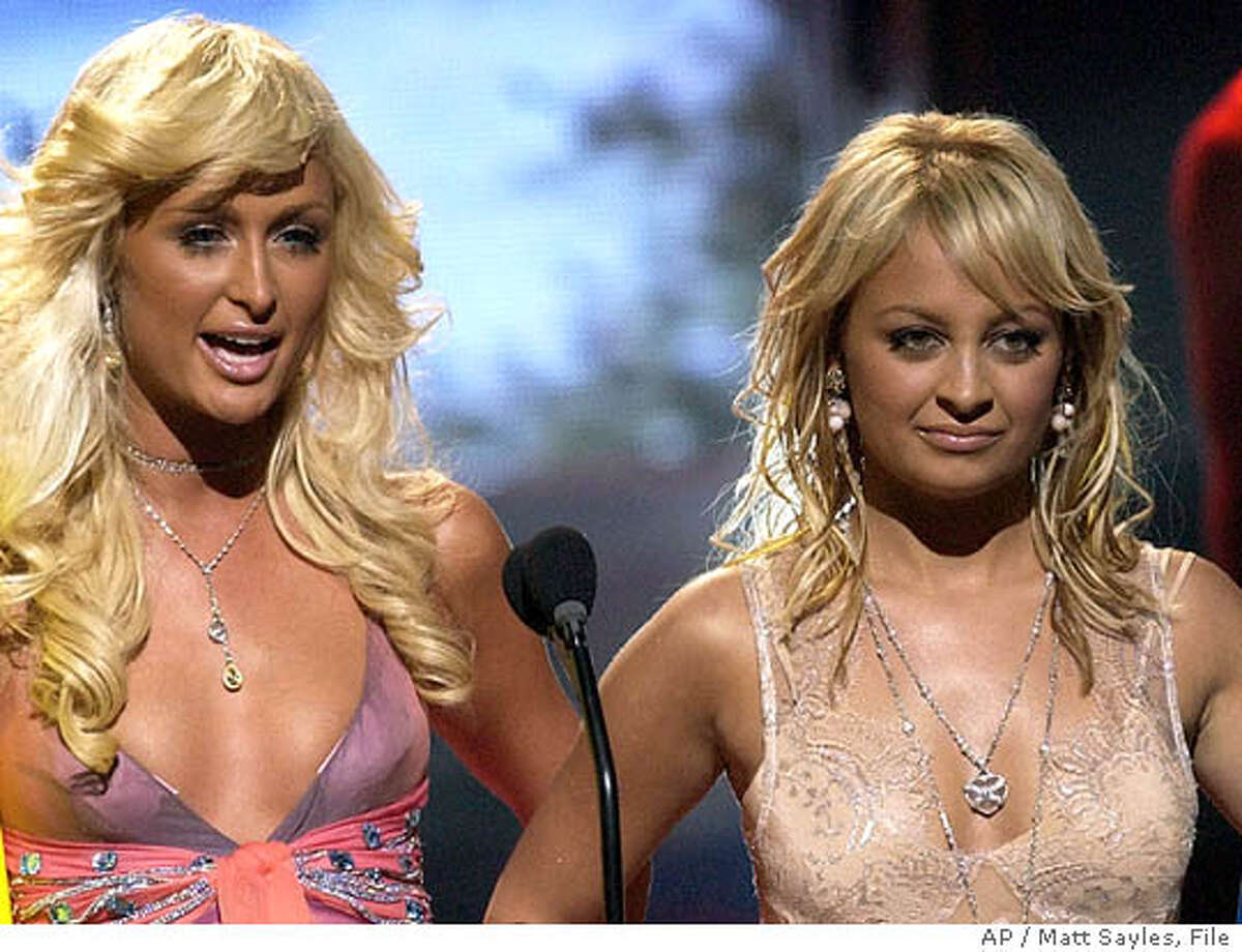**FILE**Paris Hilton and Nicole Richie host the 2004 Teen Choice Awards in Universal City, Calif. on Aug. 8, 2004. The pair are stuck together for another season of