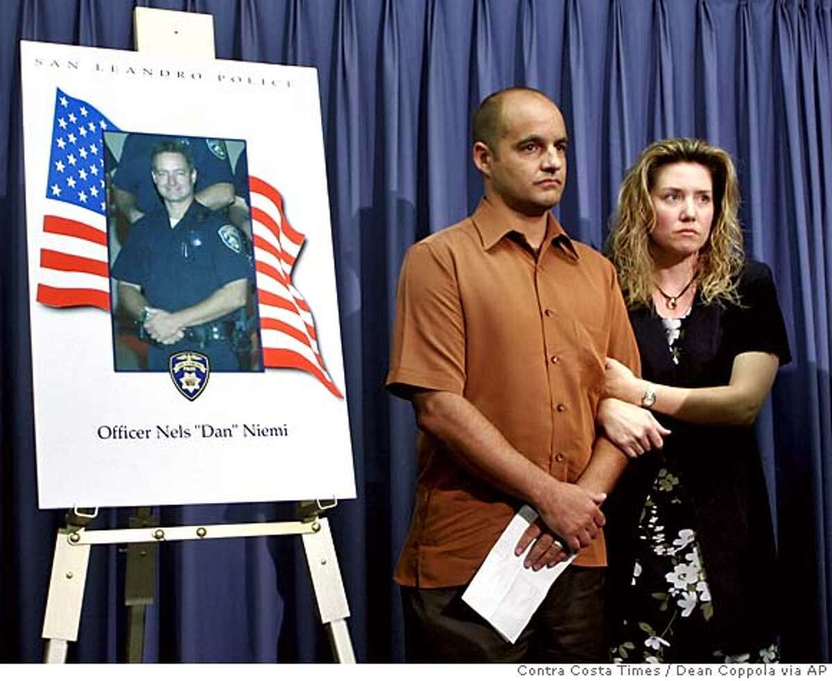Dionne Niemi, right, widow of slain San Leandro police officer Nels
