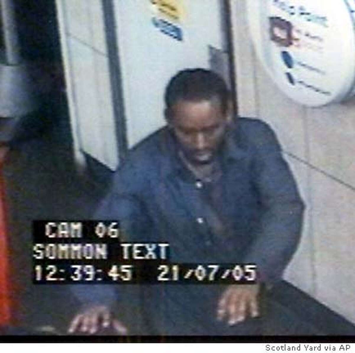 ** FILE ** Picture released by Scotland Yard of a man - named by detectives Monday July 25, 2005, as Yasin Hassan Omar - who police wish to question in connection with the four suspected suicide attacks on three Tube trains and a bus Thursday, July 21, 2005 in London. This image was taken at Warren Street - one of the three tube stations involved. Police stormed a house before dawn Wednesday July 27, 2005 and fired a stun gun to subdue a man that a witness and media reports said was Somali-born Yasin Hassan Omar, one of four men believed to have carried out the failed July 21 bombings of London's Transport system. (AP Photo/ Metropolitan Police) ** **