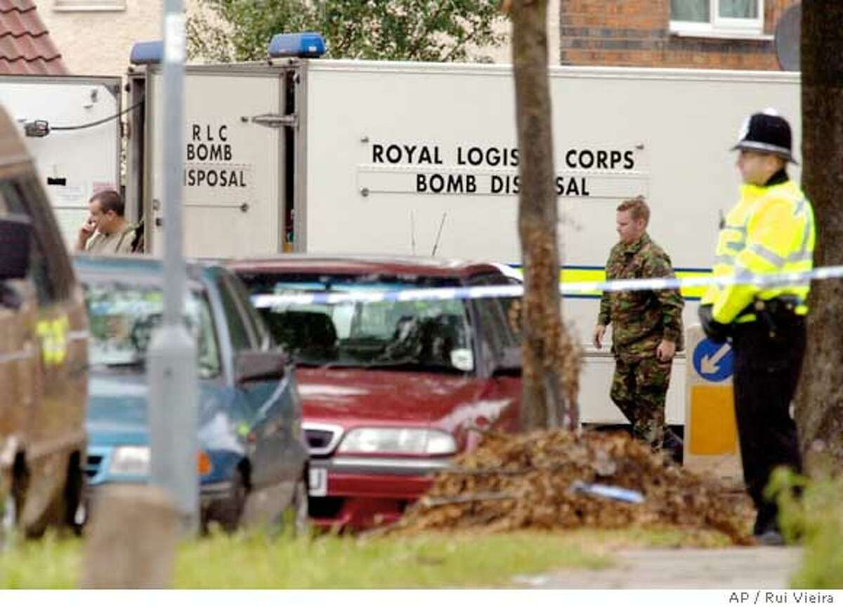 A Royal Logistic Corps bomb disposal van at Heybarnes Road, Birmingham, central England on Wednesday July 27, 2005, where detectives investigating the failed bomb attacks in London on July 21 made an arrest under the Terrorism Act 2000. The man arrested has been taken to London for further questioning. Three other men were arrested at another address in the city. (AP Photo/ Rui Vieira, PA) ** UNITED KINGDOM OUT **