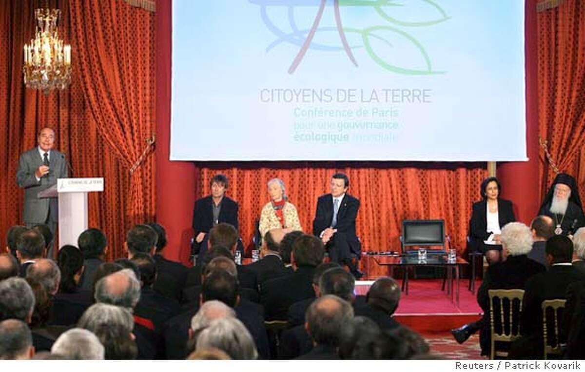 France's President Jacques Chirac (L) delivers a speech as French environmental activist Nicolas Hulot (2nd L), Britain primate expert Jane Goodall (3rd L) and European Commission President Jose Manuel Barroso (C) listen during the opening ceremony of the conference on global ecological governance at the Elysee Palace in Paris February 2, 2007. The Intergovernmental Panel on Climate Change (IPCC) presented its report assessing the human link to pollution, global warming and climate change in Paris. REUTERS/Patrick Kovarik/Pool (FRANCE)