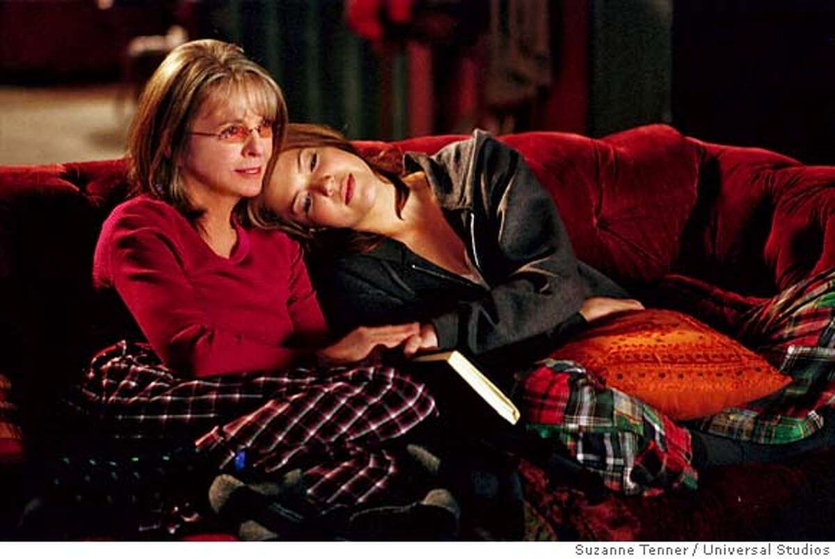 """Daphne (DIANE KEATON) and her daughter, Milly (MANDY MOORE), cuddle up for an old movie in a comedy about cutting the apron strings, """"Because I Said So"""". Photo Credit: Suzanne Tenner / Universal Studios"""