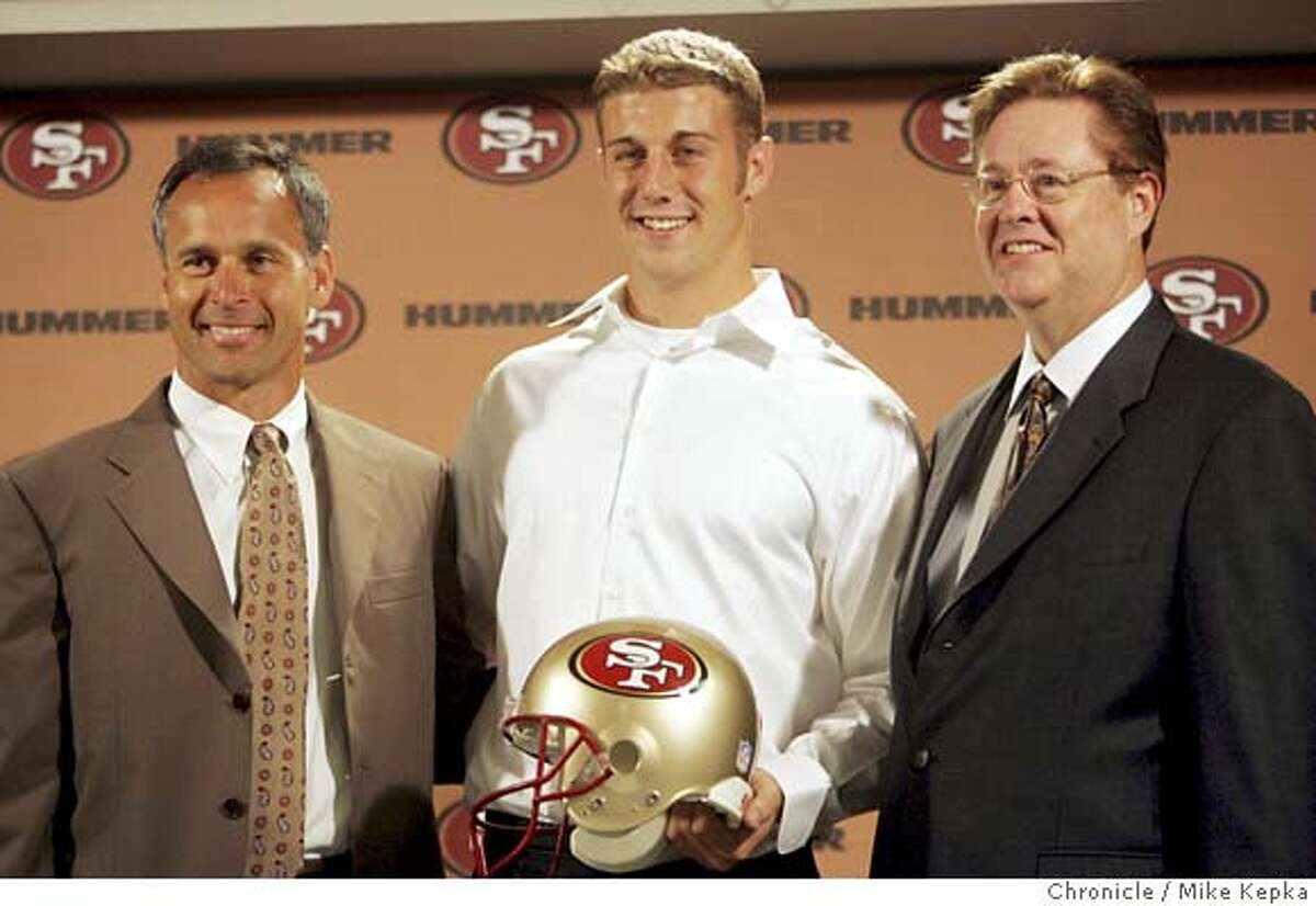 49ers121_mk.JPG Flanked by head coach Mike Nolan and Owner John York, 49ers #1 draft pick Alex Smith announces a new $24 million contract. 7/25/05 Mike Kepka / The Chronicle MANDATORY CREDIT FOR PHOTOG AND SF CHRONICLE/ -MAGS OUT
