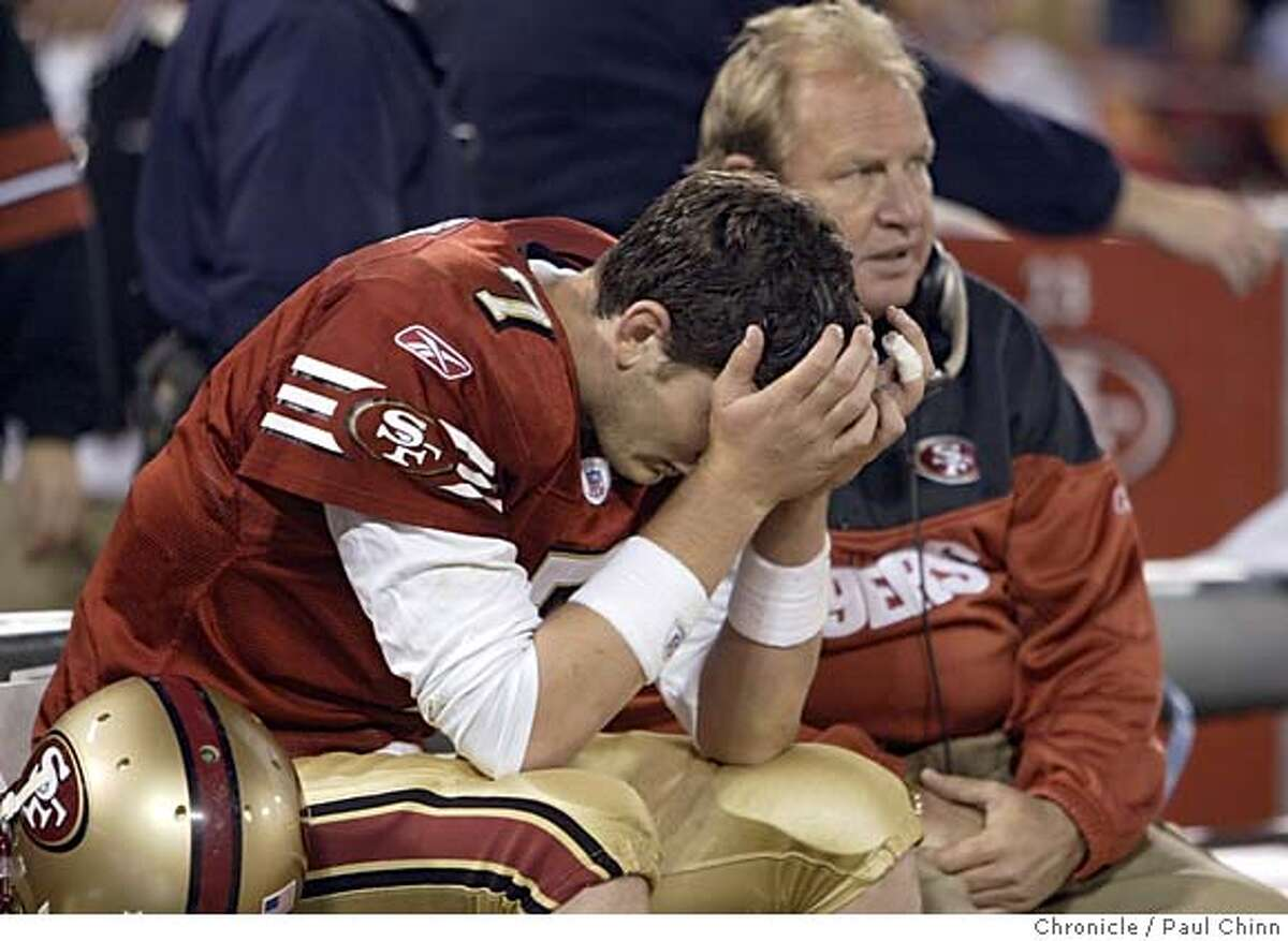 49ers19_321_pc.jpg Quarterback Ken Dorsey buries his head after throwing a late fourth quarter interception which sealed another 49er loss. Behind Dorsey is QB coach Rich Olson. San Francisco 49ers vs. Washington Redskins at Monster Park on 12/18/04 in San Francisco, CA. PAUL CHINN/The Chronicle MANDATORY CREDIT FOR PHOTOG AND S.F. CHRONICLE/ - MAGS OUT