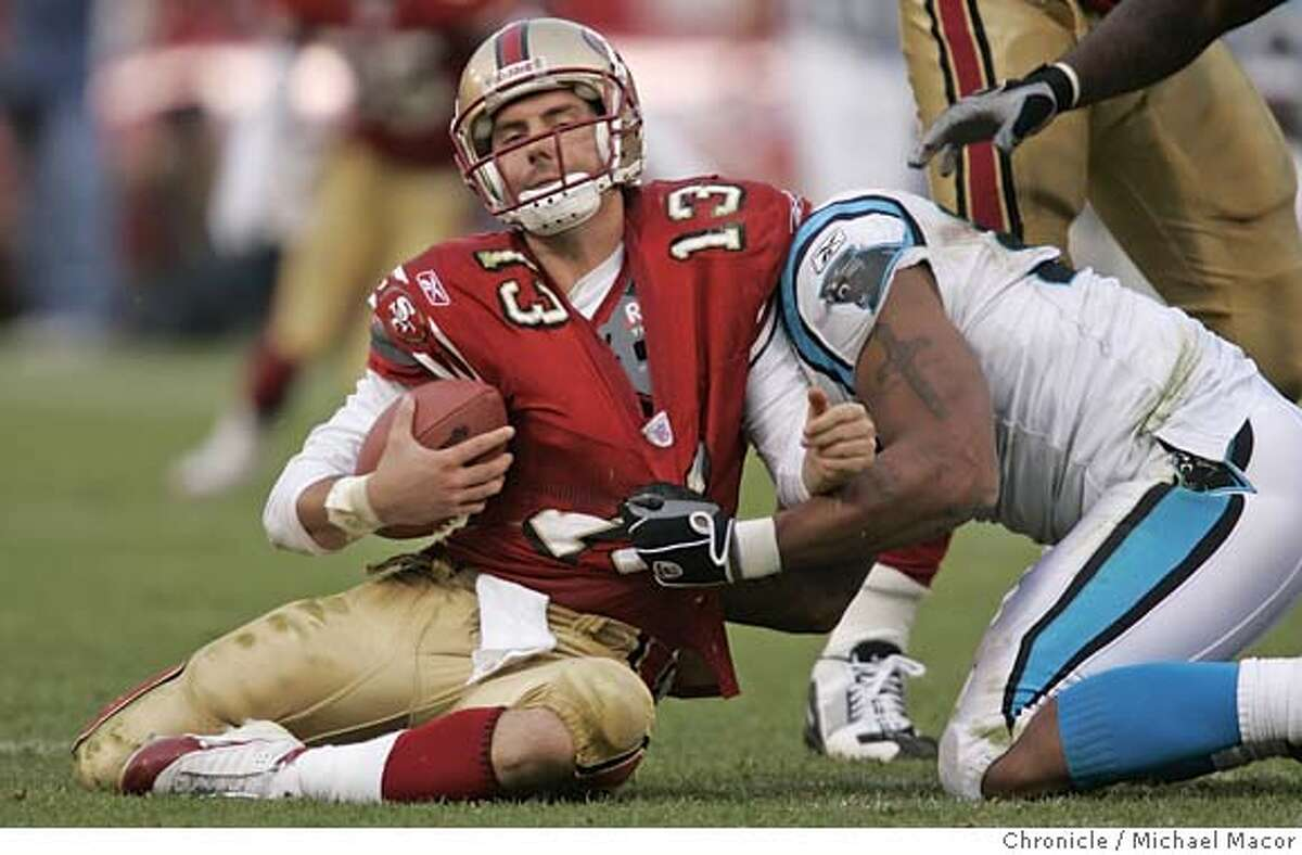 49ers_016_mac.jpg 49ers QB 13- Tim Rattay taken down for a sack by Panthers 90- Julius Peppers. San Francisco Forty Niners vs. Carolina Panthers, Monster Park. 11/14/04 San Francisco, CA Michael Macor / San Francisco Chronicle Mandatory Credit for Photographer and San Francisco Chronicle/ - Magazine Out