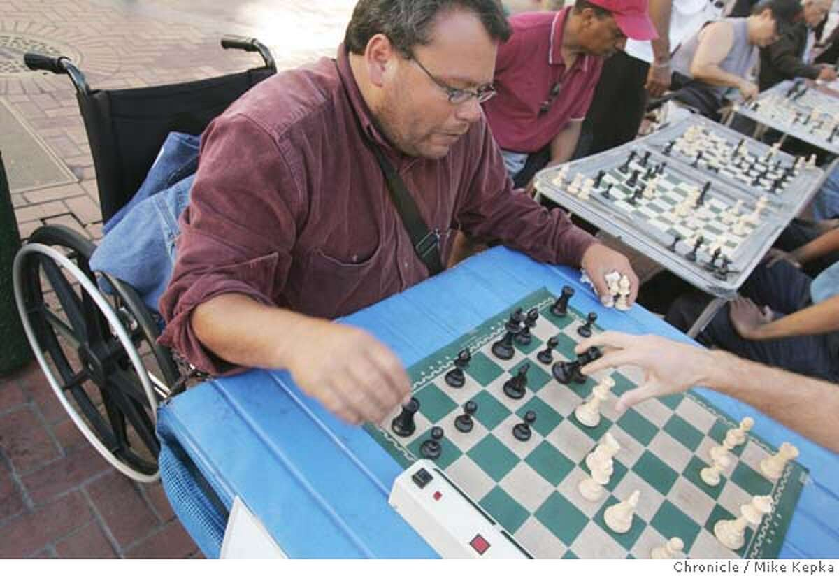 chess151_mk.JPG Maximus King runs his own table and some say he arguable the best guy out there. Chess players at Market and 5th can be found 7 days a week. 7/22/05 Mike Kepka / The Chronicle MANDATORY CREDIT FOR PHOTOG AND SF CHRONICLE/ -MAGS OUT