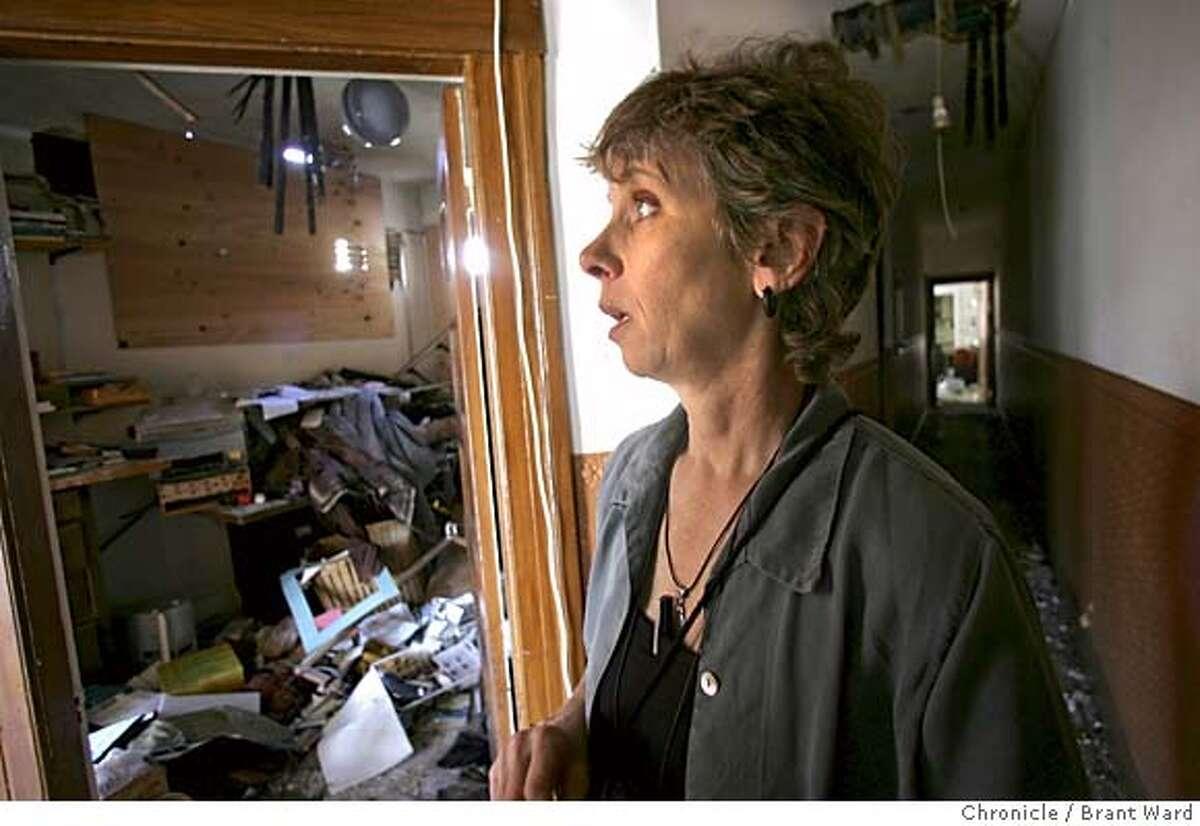 gjelten217_ward.jpg Elizabeth Gjelten takes a walk in her apartment hallway two weeks after a fire ruined her home. Elizabeth Gjelten is a San Francisco playwright whose work