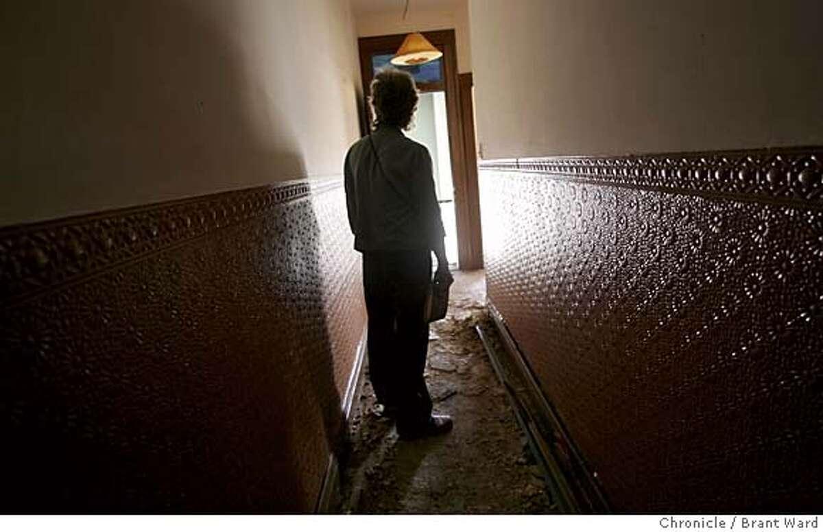 gjelten235_ward.jpg Elizabeth Gjelten looks down the hallway of her apartment which was ravaged by fire two weeks ago. Elizabeth Gjelten is a San Francisco playwright whose work