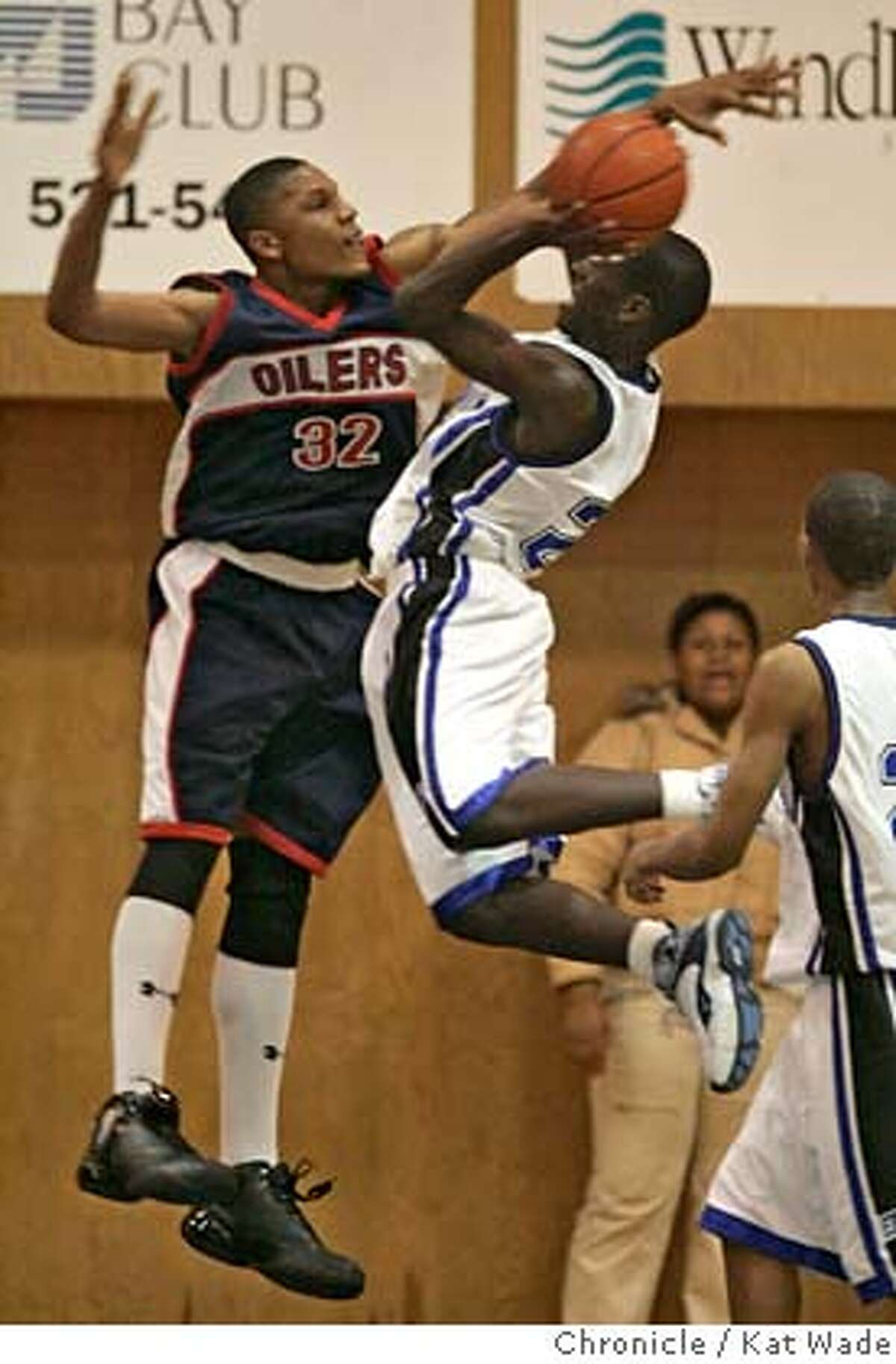 RICHMOND02_220_KW_.jpg The Oilers Elijah Holman, (LEFT) back for his first game in 14 months since a suspension and after being shot blocks #22 Mario Brown during the second half of the game on February 2, 2007 when Richmond High School Oilers beat the Encinal High School Jets in Alameda at Encinal during the last few minutes of the game. Kat Wade/The Chronicle Mandatory Credit for San Francisco Chronicle and photographer, Kat Wade, Mags out