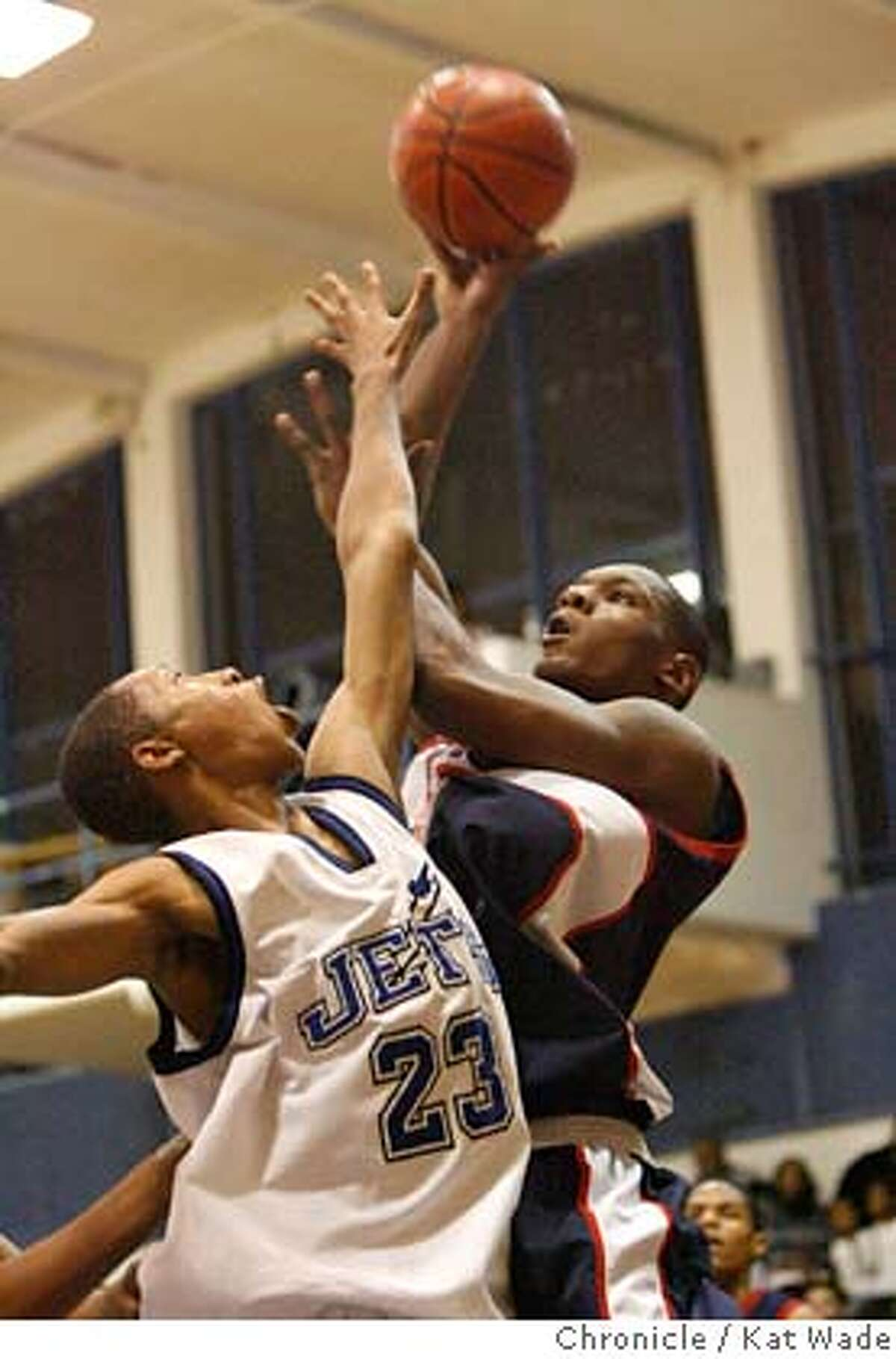 RICHMOND02_226_KW_.jpg The Oilers Wendell McKines (RIGHT) who has scored an average of 40 points per game this season goes up for a basket with pressure from the Jet's #23 James Peterson during the second half of the game on February 2, 2007 when Richmond High School Oilers beat the Encinal High School Jets in Alameda at Encinal during the last few minutes of the game. Kat Wade/The Chronicle Mandatory Credit for San Francisco Chronicle and photographer, Kat Wade, Mags out