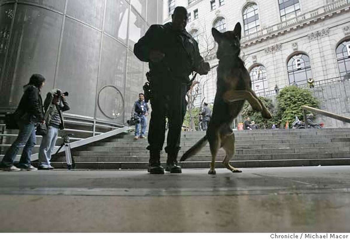 k9_037_mac.jpg Powell St. MUNI station downtown San Francisco. San Francisco Police Officer Kelly Wesley with