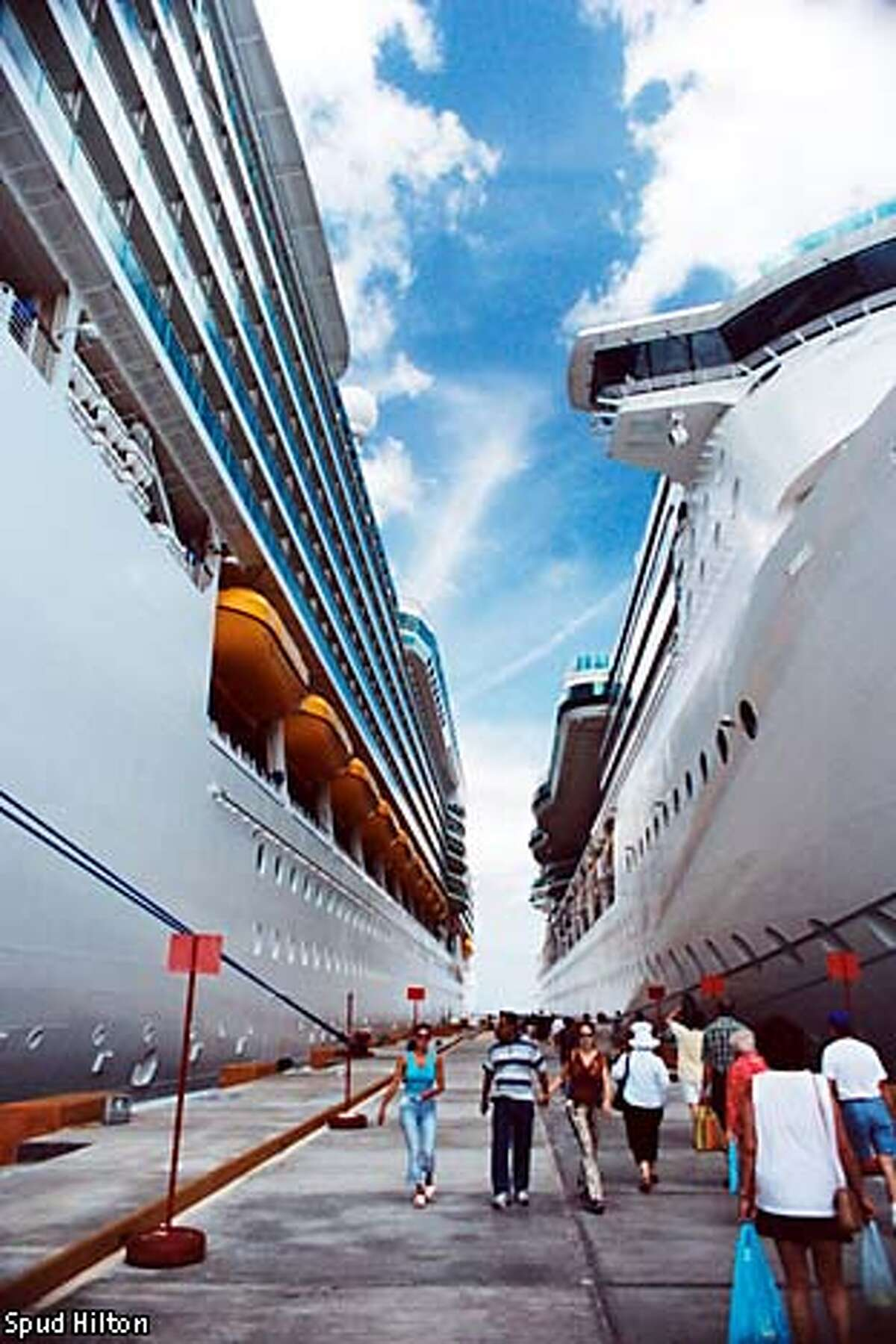 Big sister: The sky-scraping Navigator of the Seas, left, shares a pier in Cozumel, Mexico, with smaller sibling Brilliance of the Seas. Photo by Spud Hilton, special to the Chronicle