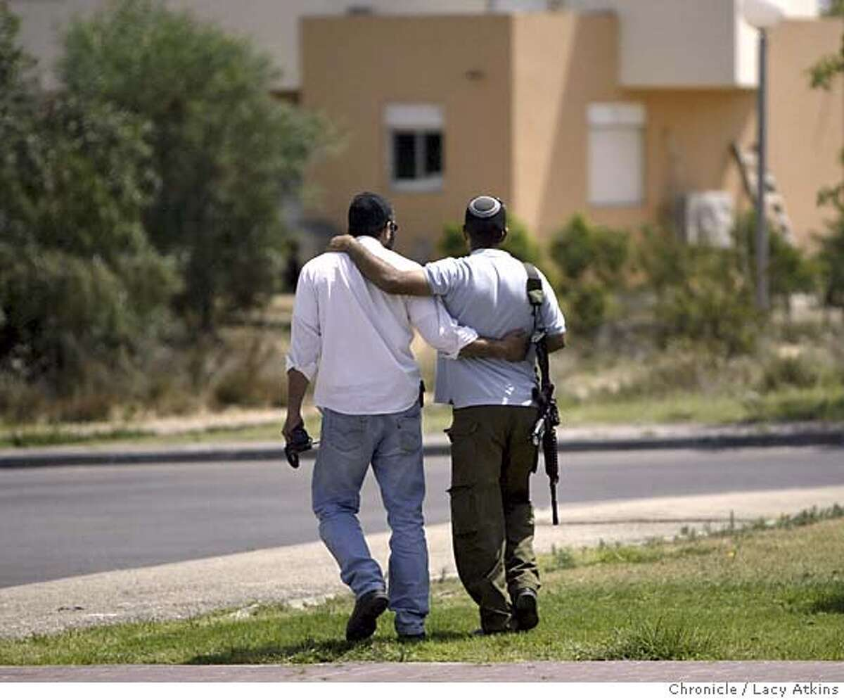 Yaniv Ben Hagaz Levy, left walks home with his brother, May 22, 2005, in the Elei Sinai settlement in Gush Katif Levy relocated when he was 13 from the Yamit Sinai settlement and now is having to leave the Elei Sinai settlement during the disengagement in August. Photographer Lacy Atkins