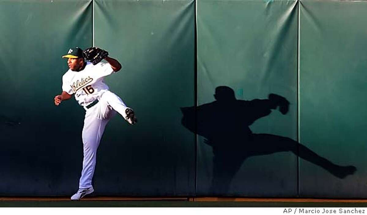Oakland Athletics centerfielder Jay Payton makes a leaping catch on a line drive by the Cleveland Indians' Jhonny Peralto in the first inning on Tuesday, July 26, 2005 in Oakland, Calif. (AP Photo/Marcio Jose Sanchez)