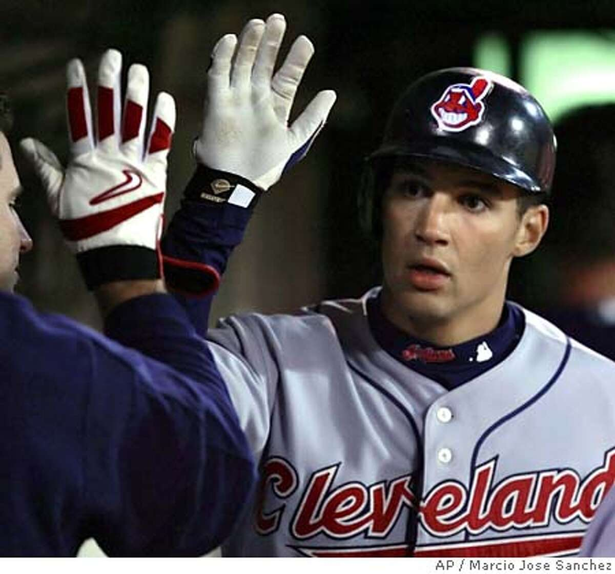 Cleveland Indians' Grady Sizemore, right, is greeted in the dugout by teammates after a solo home run off Oakland Athletics reliever Jay Witasick in the eighth inning Tuesday, July 26, 2005, in Oakland, Calif. (AP Photo/Marcio Jose Sanchez)