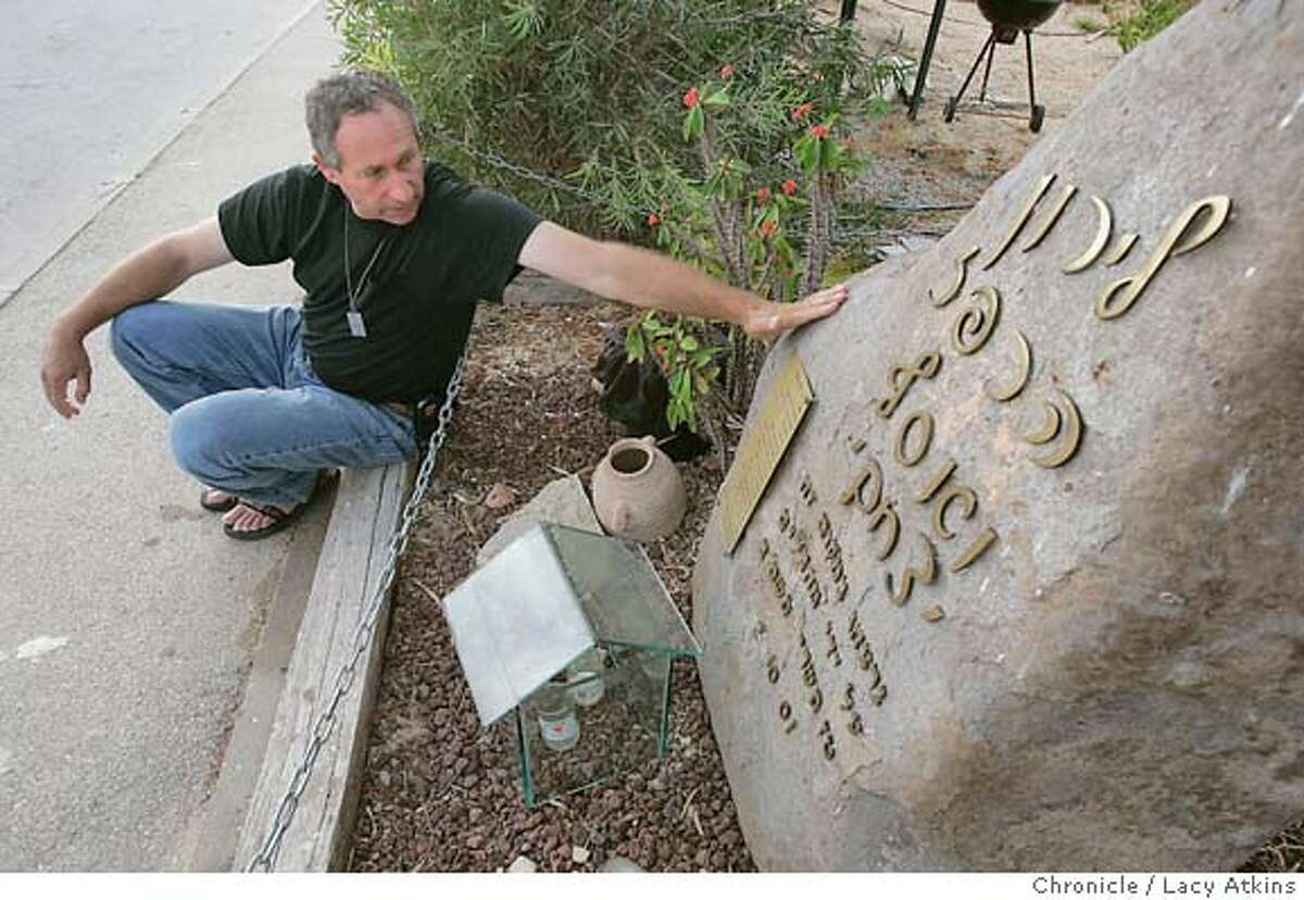 Arik Harpaz remembers his daughter Liron who was killed, October 2, 2001, near her home, in the Elai Sinai settlement in Gush Katif. Arik says when they make him move in the disengagment he will take the memorial rock with him to his new home. Photographer Lacy Atkins