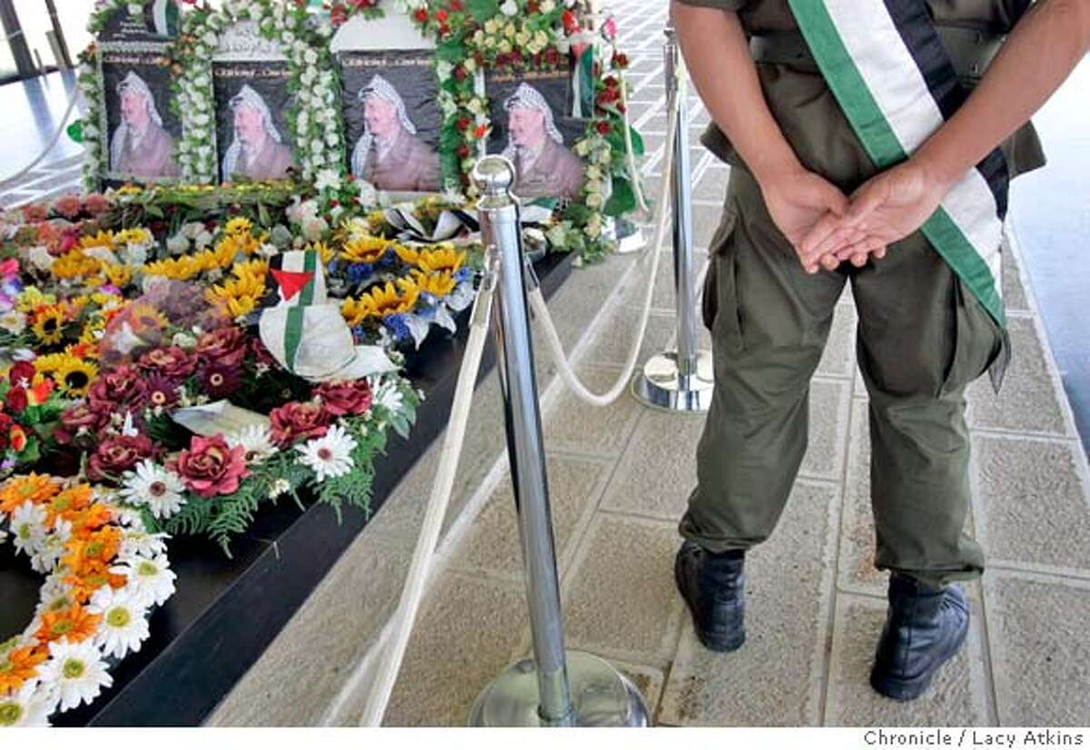 Soilders stand guard at Yasser Arafat's tomb inside his compound in Ramallah, MAy 31, 2005, in the West Bank. Photographer Lacy Atkins