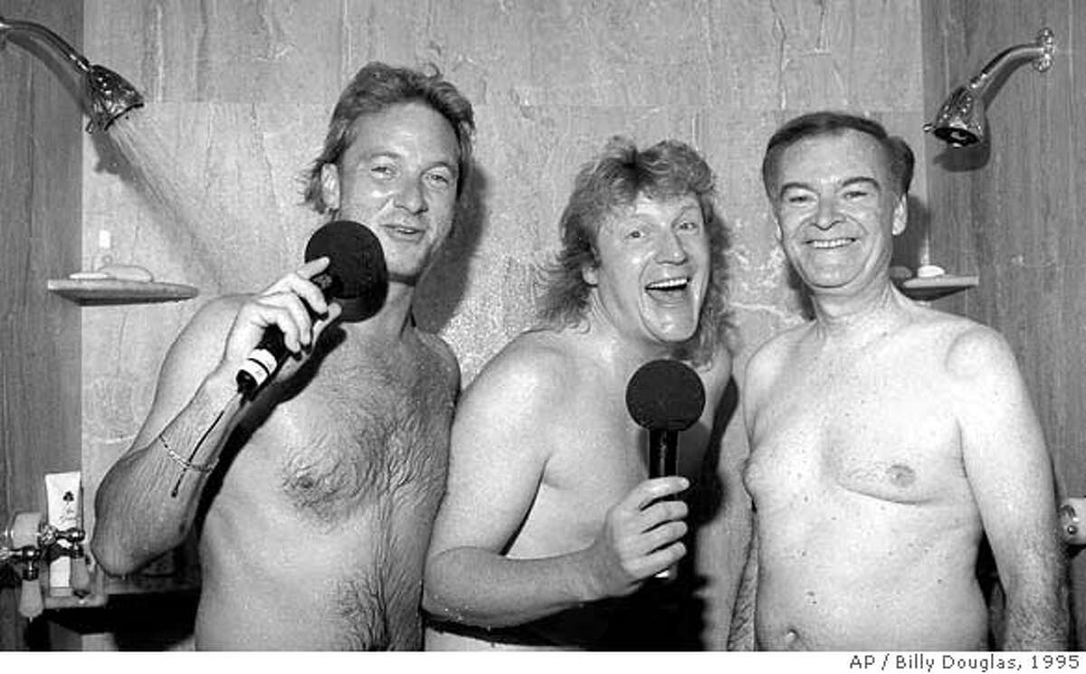 San Francisco Mayor Frank Jordan, right, joins KRQR morning radio show hosts Mark Thompson, left, and Brian Phelps, center, in the shower at his home in San Francisco, Friday Oct. 27, 1995. The Los Angeles-based syndicated radio personalities persuaded the mayor to shower with them while conducting an internet survey. The mayor is facing a close election within a couple weeks.(AP Photo/Billy Douglas, Pat Johnson Studios) CAT
