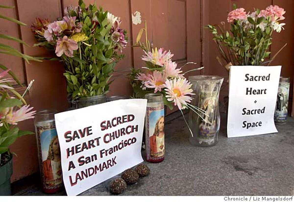sacredheart051_lm.JPG Event on 7/27/05 in San Francisco. Flowers and candles in front of the front door of the church. Folks from Sacred Heart church gather in front of the church on Fillmore Street after it was purchased and hopefully will be reopened. Liz Mangelsdorf / The Chronicle MANDATORY CREDIT FOR PHOTOG AND SF CHRONICLE/ -MAGS OUT