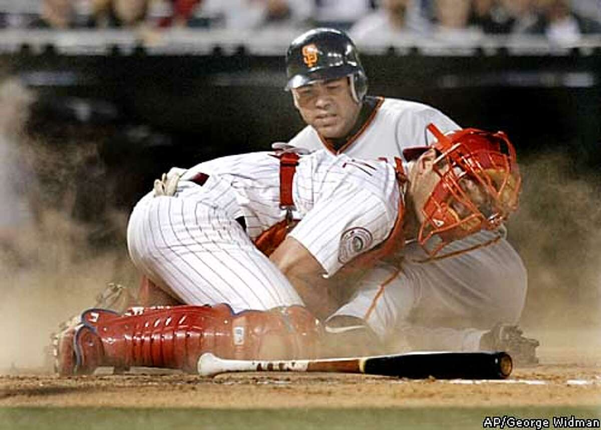 San Francisco Giants Edgardo Alfonso is tagged out at the plate by Philadelphia Phillies catcher Mike Lieberthal in the third inning Friday, April 25, 2003 in Philadelphia. Alfonso tried to score from first on a double by Barry Bonds. (AP Photo/George Widman)