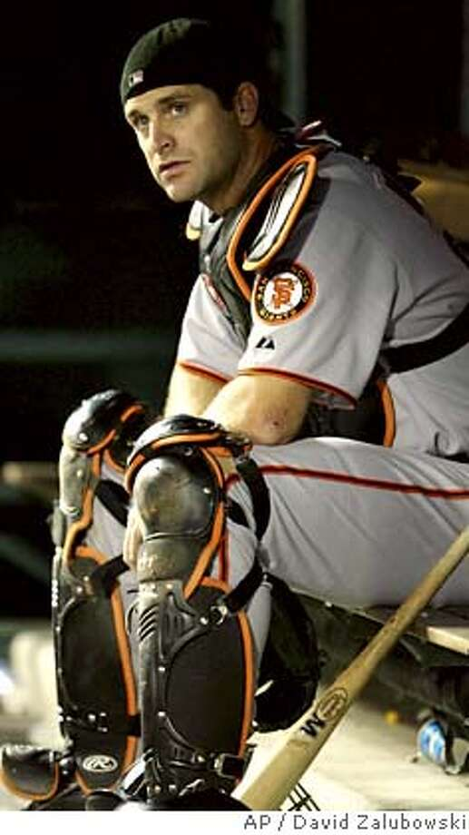 ** FILE ** ADVANCE FOR THE WEEKEND OF AUG. 19-20 ** In this file photo from Friday, April 21, 2006, San Francisco Giants catcher Mike Matheny sits in the dugout in Denver, Colo. Matheny has been sidelined after suffering a concussion when a series of foul tips caromed off his mask with such force that they damaged his brain. (AP Photo/David Zalubowski)  Ran on: 08-20-2006  Mike Matheny ended his season due to concussion issues. His future is uncertain. ADVANCE FOR THE WEEKEND OF AUG. 19-20 APRIL 21 FILE PHOTO Photo: DAVID ZALUBOWSKI