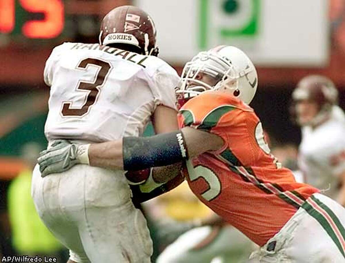 ** FOR USE ANYTIME WITH 2003 STORIES ** FILE ** Miami defensive end Jerome McDougle, right, brings down Virginia Tech quarterback Bryan Randall (3) during the first half in this Dec. 7, 2002 photo, at the Orange Bowl in Miami. McDougle is a top prospect in the upcoming 2003 . (AP Photo/Wilfredo Lee)