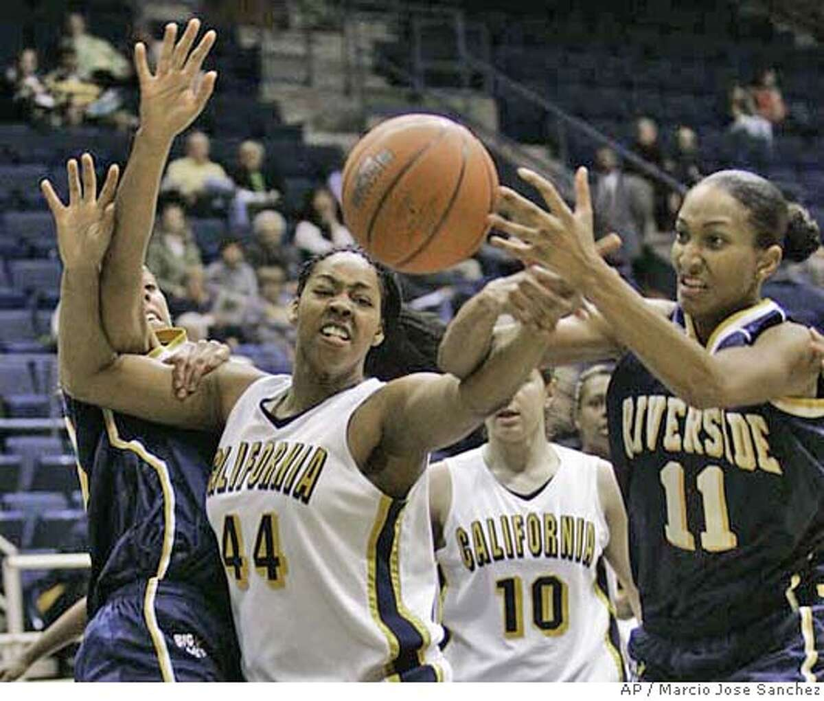California's Ashley Walker, center, fights for a rebound against UC Riverside's Kemie Nkele, left, and Roney Friend in the first half of a basketball game in Berkeley, Calif., Wednesday, Jan. 31, 2007.(AP Photo/Marcio Jose Sanchez)