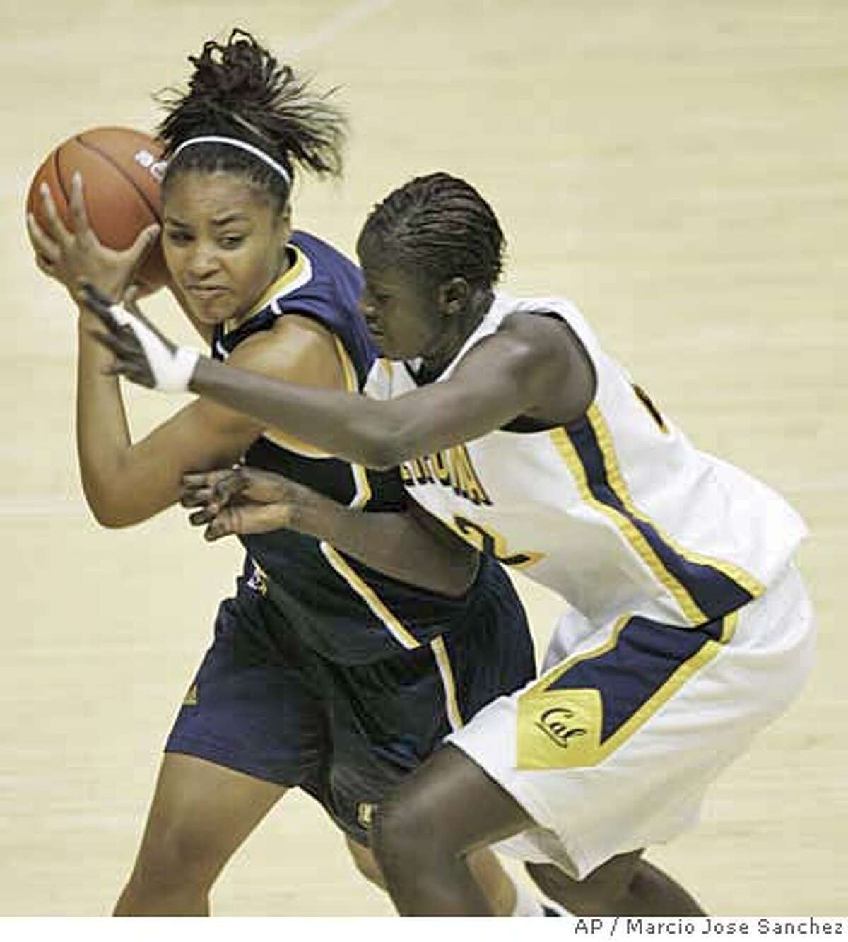 UC Riverside's Brittany Waddell, left, is defended by California's Rama N'Diaye in the second half of a basketball game in Berkeley, Calif., Wednesday, Jan. 31, 2007. California won 58-51. (AP Photo/Marcio Jose Sanchez)