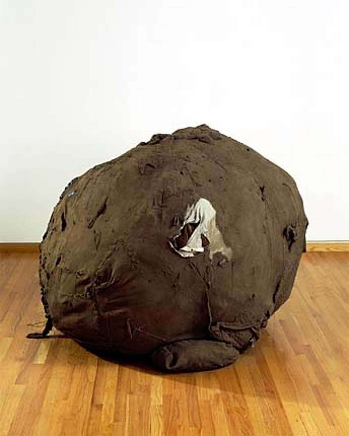 THIS IS A HANDOUT IMAGE. PLEASE VERIFY RIGHTS. Ball_us.jpg Kathryn Spence Untitled, 2003 mud, clothes, curtains, blankets, towels, string, lint 47 x 61 x 64 inches HANDOUT PHOTO/VERIFY RIGHTS AND USEAGE