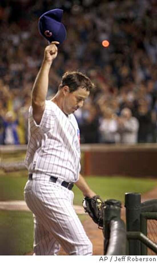 Chicago Cubs starting pitcher Greg Maddux tips his cap after striking out San Francisco Giants' Omar Vizquel for the 3,000 strikeout of his career to end the third inning Tuesday, July 26, 2005 in Chicago. (AP Photo/Jeff Roberson) Photo: JEFF ROBERSON