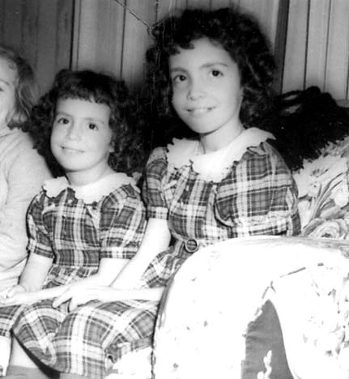 Fanos, left, poses for a childhood portrait with her older sister, Judy, who died of cystic fibrosis.
