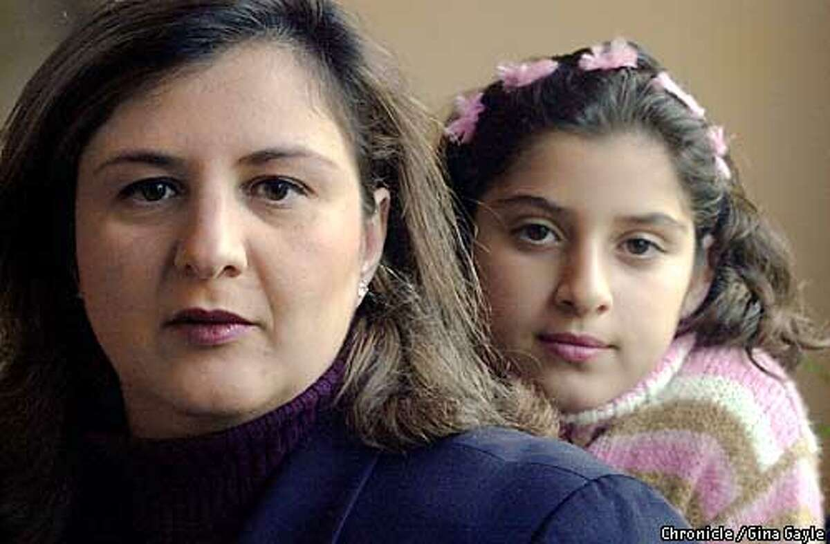 Maha Alshibib Joudi, an Iraqui exile who lives in San Ramon with her family. Shown in some photos with her daughter Noor Joudi,9. 4/25/03 in San Ramon. GINA GAYLE / The Chronicle