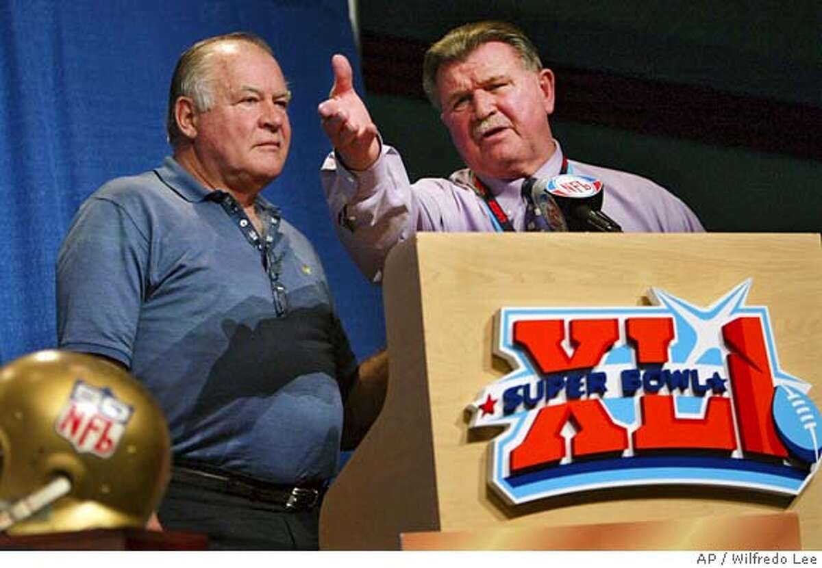 Former Chicago Bears coach Mike Ditka, right and Jerry Kramer, former lineman for the Green Bay Packers, announce an online auction and donation drive to provide financial assistance to retired NFL players at the Miami Beach Convention Center in Miami Beach, Fla., Thursday, Feb. 1, 2007. The mementoes will be collected from NFL players for the online auction. (AP Photo/Wilfredo Lee)
