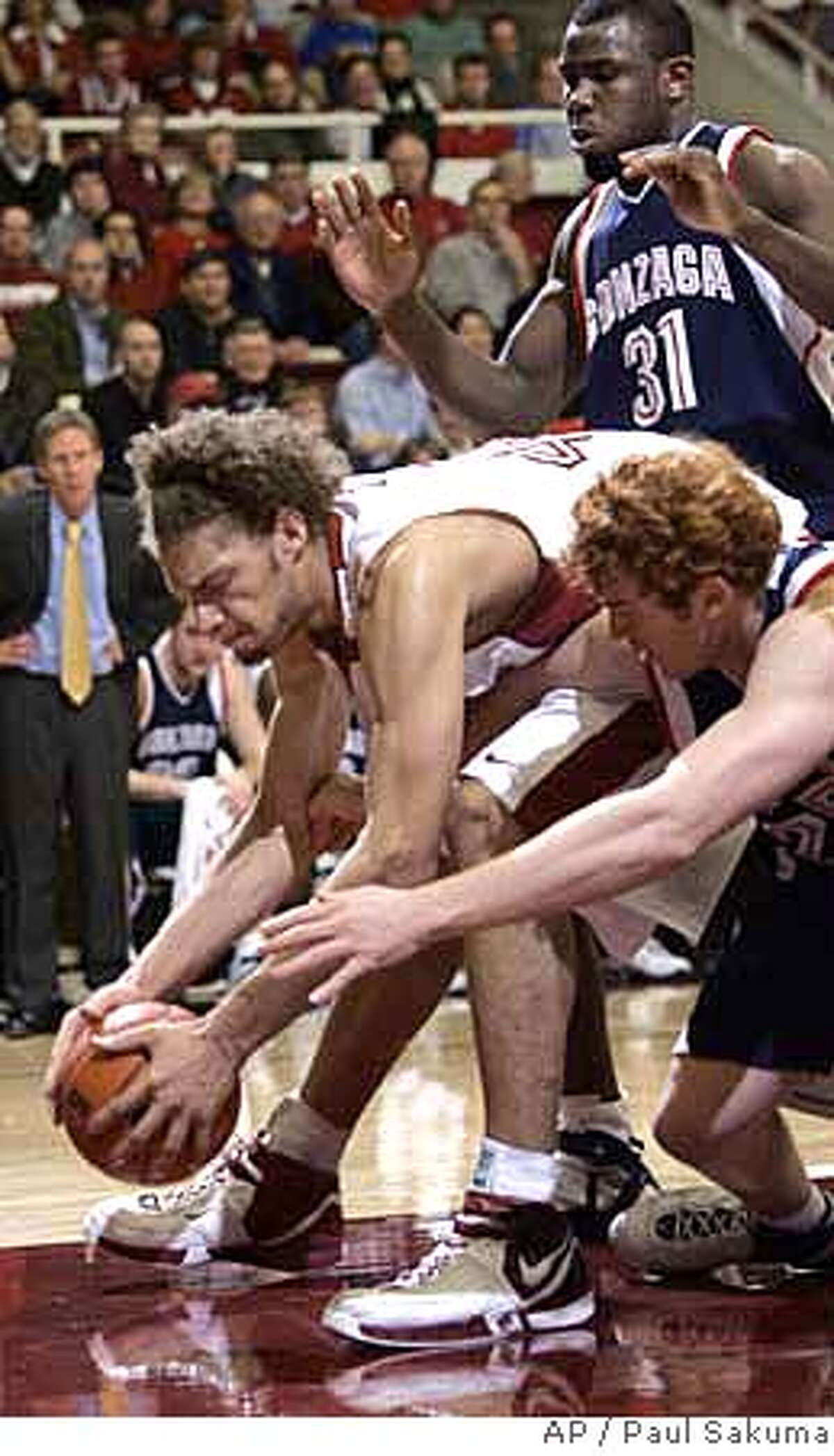 Stanford center Robin Lopez, left, grabs the ball in front of Gonzaga guard David Pendergraft, right, in the first half of their NCAA basketball game in Stanford, Calif., Thursday, Jan. 31, 2007. (AP Photo/Paul Sakuma)