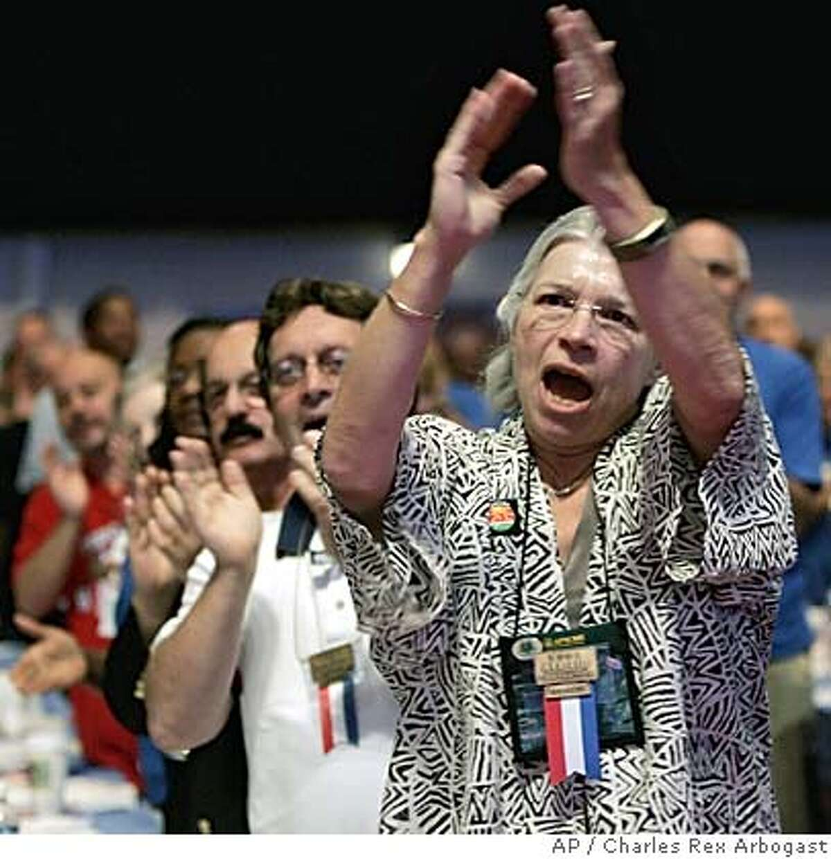 Patricia Moss, from Columbus, Ohio, a member of the ASFCME local in Columbus and a delegate to the AFL-CIO's national convention, applauds remarks made by the Rev. Jesse Jackson at Chicago's Navy Pier Tuesday, July 26, 2005. (AP Photo/Charles Rex Arbogast)