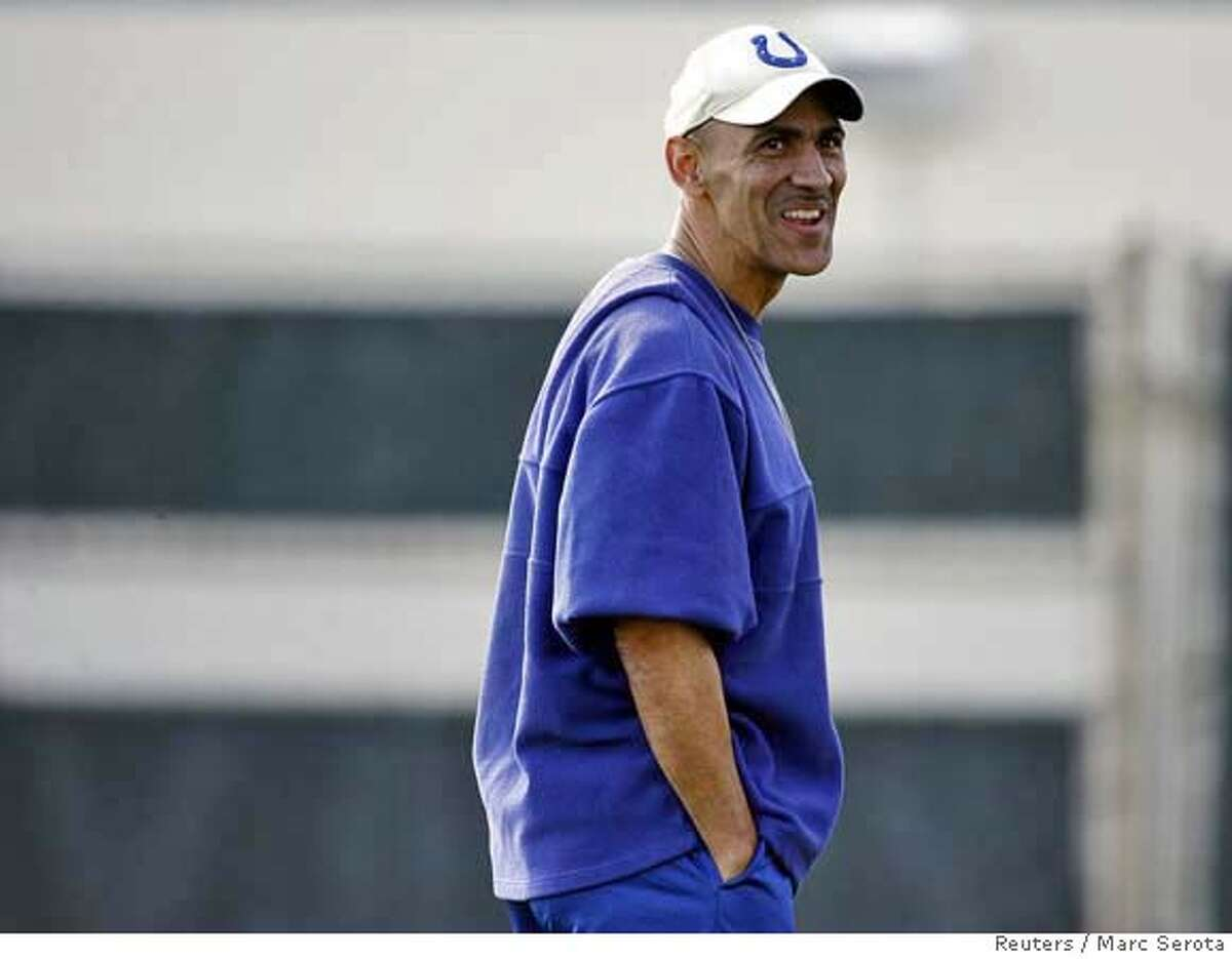 Indianapolis Colts coach Tony Dungy laughs during team practice in Davie, Florida January 31, 2007. The Colts will take on the Chicago Bears in Super Bowl XLI on February 4, in Miami, Florida. REUTERS/Marc Serota (UNITED STATES) 0