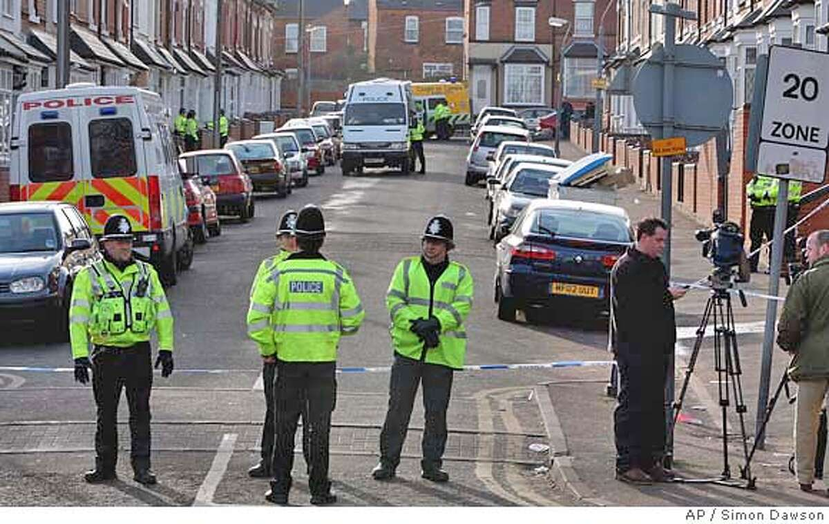 British police officers cordon off access to a street in Birmingham, England after police arrested suspected terrorists Wednesday Jan. 31, 2007. British counter-terrorism police carrying out pre-dawn raids in the city of Birmingham arrested eight men accused of planning a kidnapping, police said. The men were accused of committing, preparing or instigating terrorism, police said. (AP Photo/ Simon Dawson)