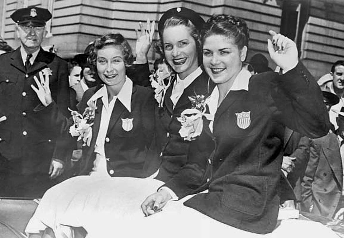 homan_134_el.JPG From the parade on Market celebrating the 1948 Games, Barbara Jensen,, Ann Curtis (Cuneo),2 Golds and 1 Silver and Patty Elsener Homan came home with 1 Silver and 1 Bronze. Patty Elsener Homan was an olympic diver. she trained at the Fairmont Plunge in the Fairmont Hotel, which became the Tonga Room. Need photo of Homan with her Olympic medals to go with story on the plunge, which operated in the 1930s and early 40s. She'll be at her home, with her medals. Event on 7/18/05 in San Bruno Eric Luse / The Chronicle MANDATORY CREDIT FOR PHOTOG AND SF CHRONICLE/ -MAGS OUT