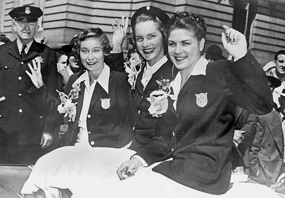 homan_134_el.JPG  From the parade on Market celebrating the 1948 Games, Barbara Jensen,, Ann Curtis (Cuneo),2 Golds and 1 Silver and Patty Elsener Homan came home with 1 Silver and 1 Bronze.  Patty Elsener Homan was an olympic diver. she trained at the Fairmont Plunge in the Fairmont Hotel, which became the Tonga Room. Need photo of Homan with her Olympic medals to go with story on the plunge, which operated in the 1930s and early 40s. She'll be at her home, with her medals.  Event on 7/18/05 in San Bruno Eric Luse / The Chronicle MANDATORY CREDIT FOR PHOTOG AND SF CHRONICLE/ -MAGS OUT Photo: Eric Luse