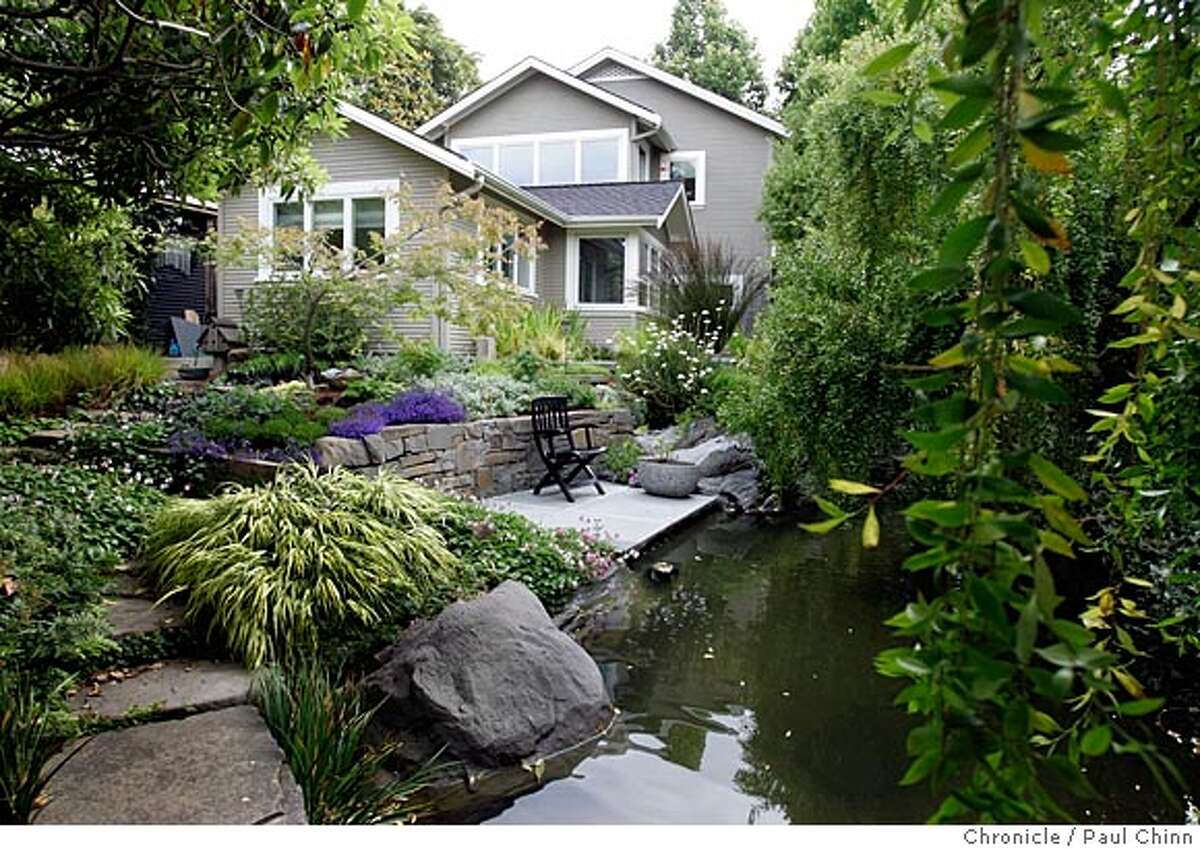 The Potomac Waterworks backyard garden at the home of landscape architect Paul Cowley and his wife Robin on 6/24/05 in Oakland, Calif. The garden features fountains, a pond and two streams. PAUL CHINN/The Chronicle