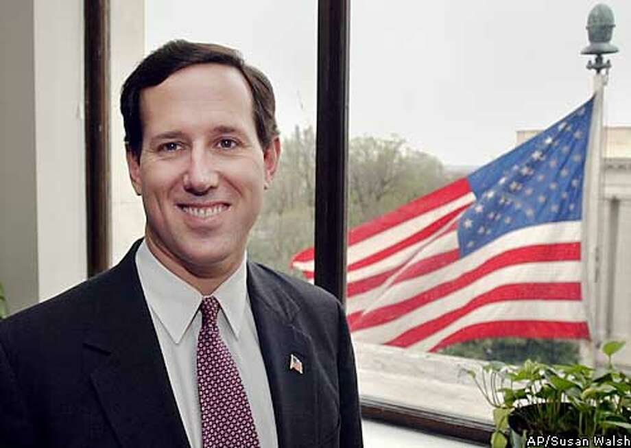 **ADVANCE FOR MONDAY APRIL 21** Sen. Rick Santorum, R-PA., in his office on Capitol Hill, IN Washington, Friday, April 11, 2003. (AP Photo/Susan Walsh) Photo: SUSAN WALSH