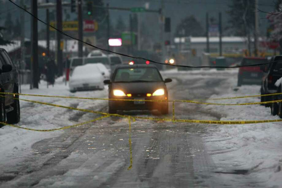 a car stops because of a downed power line on Friday, January 20, 2012 in Auburn. An ice storm wreaked havoc in the area, bringing down trees and power lines. Power was out in large parts of the area. Photo: JOSHUA TRUJILLO / SEATTLEPI.COM